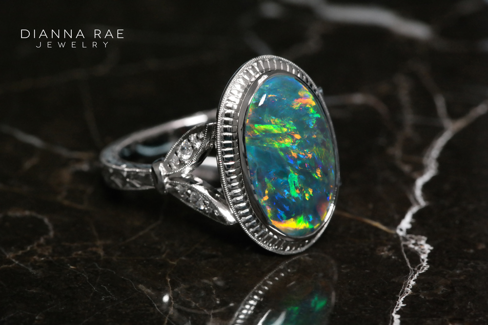 001-01619-001_Opal Ring Engraved_front marble.JPG