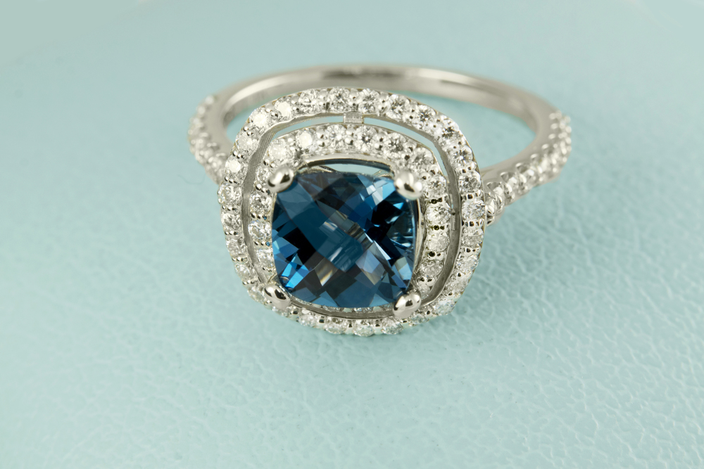 Double Halo Blue Topaz Ring.jpg