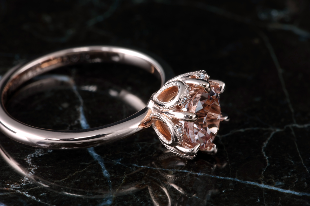 Rose Gold with a diamond halo accent. In Stock Now - $825