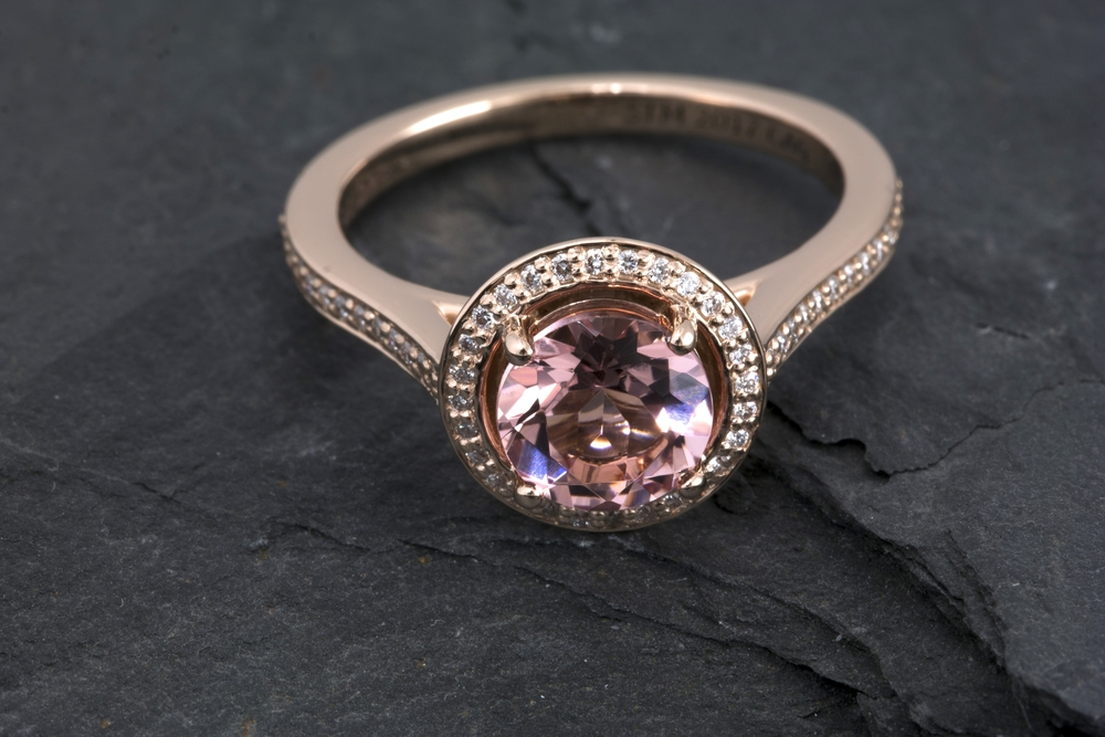 Stunning Morganite in Rose Gold with a diamond halo accent.