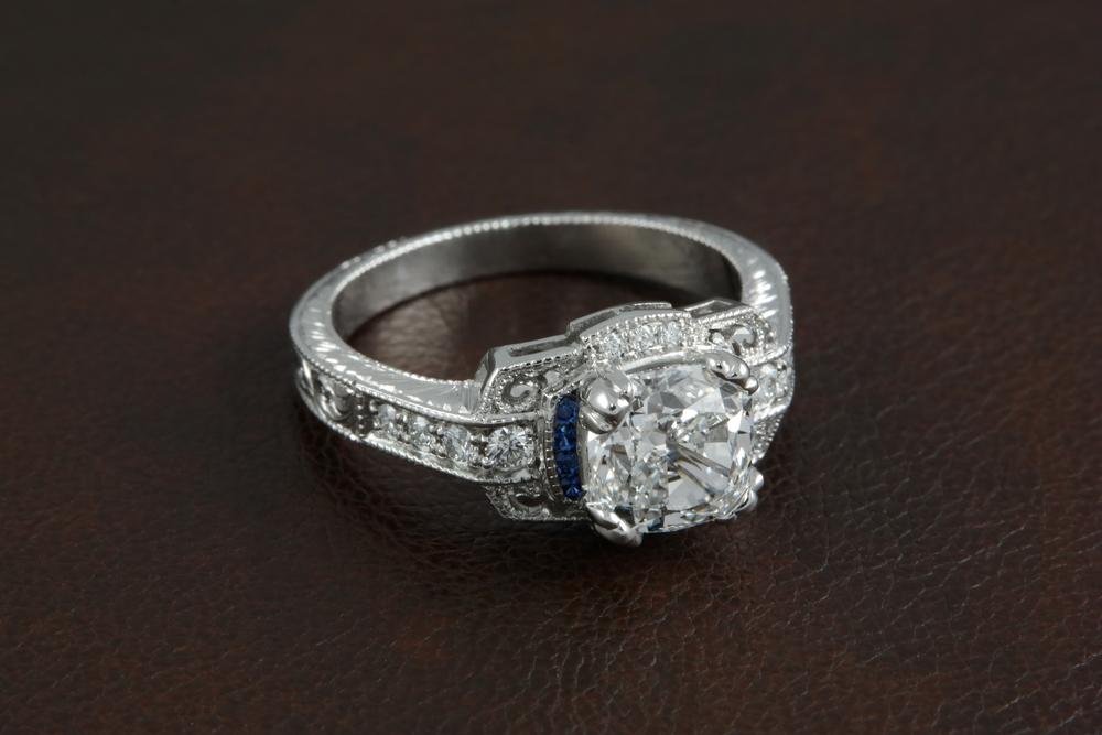 Tim Mannon - 001-00628-001 - Platinum Vintage Eng Ring - On Leather.jpg
