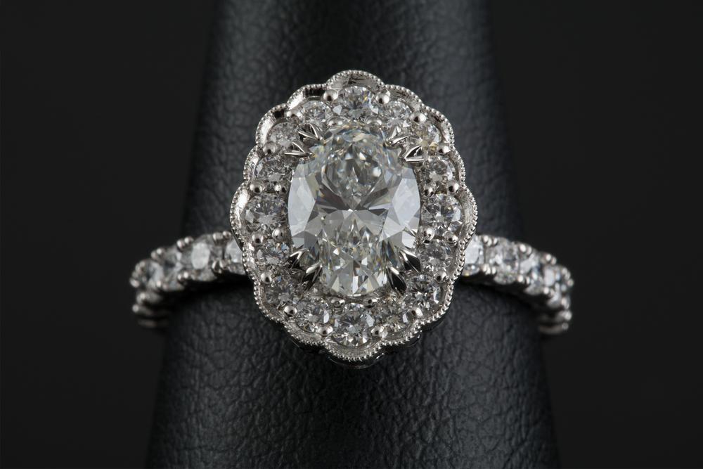 001-02336-002_Custom Platinum Oval Diamond Ring_Finger.jpg