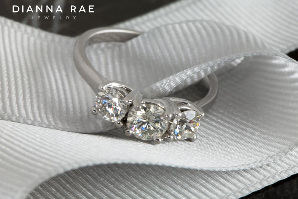 001-02656-001_John Campbell_Custom Three Stone Engagement Ring_Ribbon.jpg