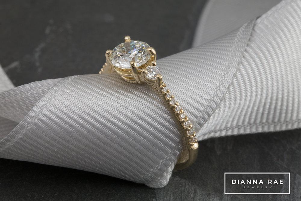 001-02800-001_Wesley Austin_Custom Three Stone Engagement Ring_Ribbon.jpg