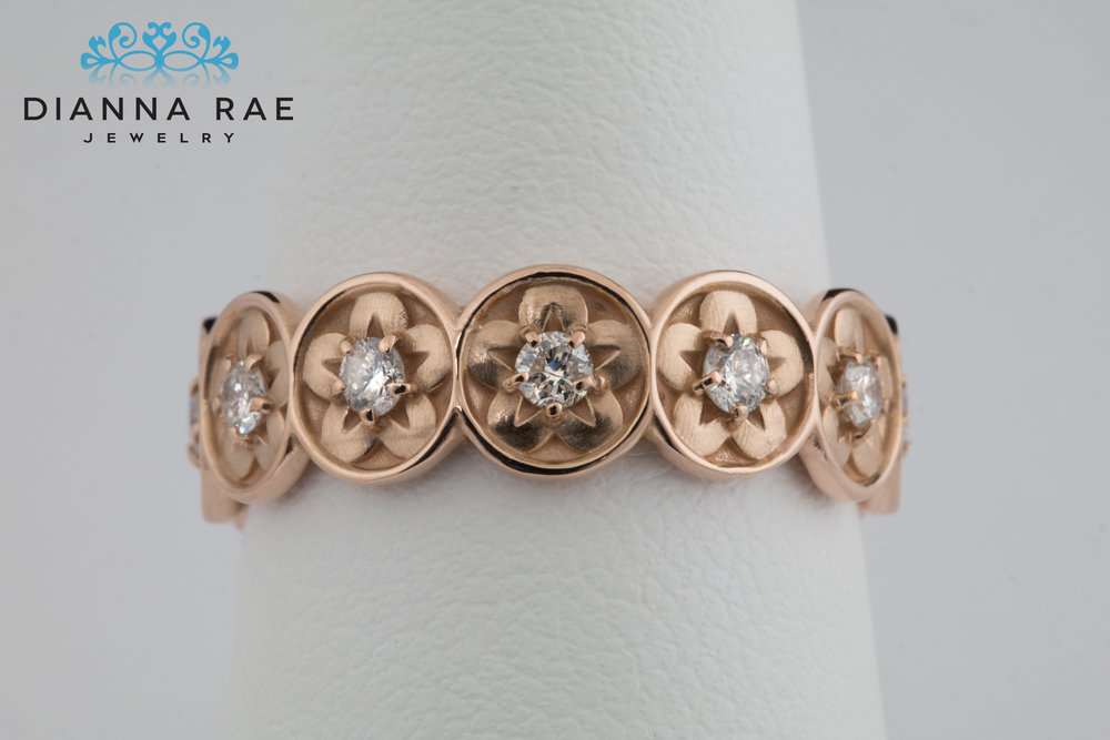 001-03016-001_Custom Stackable Diamond Flower Wedding Band_Finger.jpg