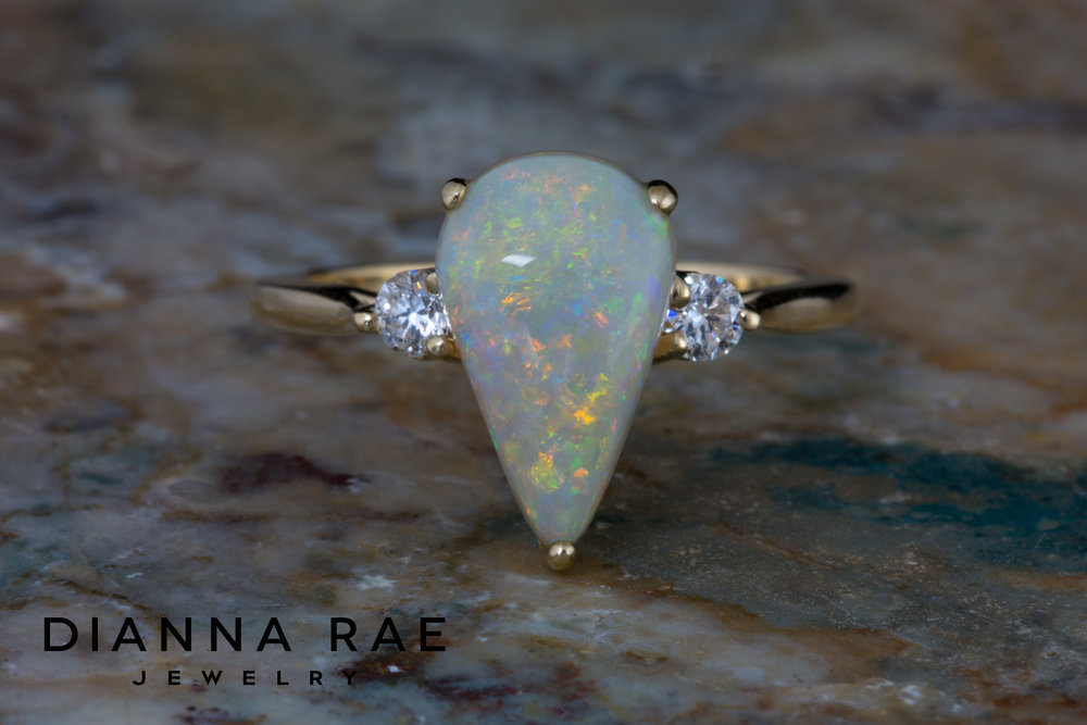DRJ9003_Pear White Opal Ring with Two Side Diamonds_1.jpg