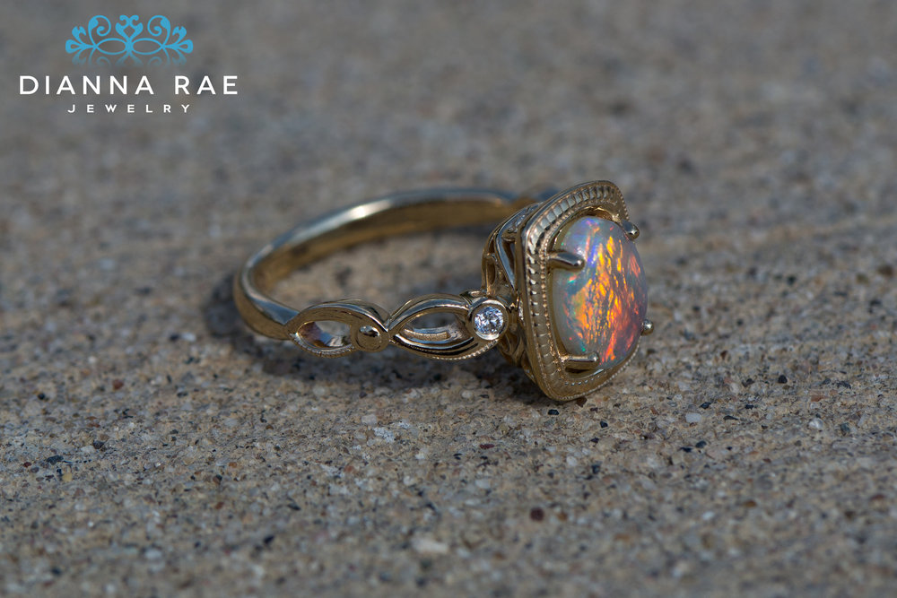 DRJ9006_Oval Black Opal Yellow Gold Rope Halo Ring_2.jpg
