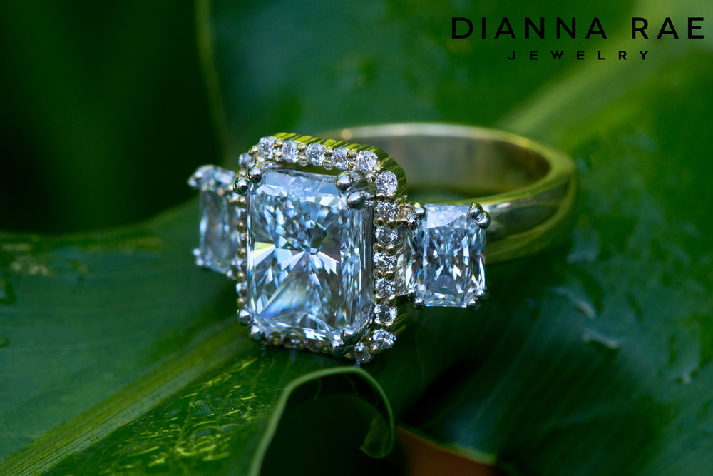 001-02804-001_Custom Radiant Three Stone Engagement Ring with Center Halo_Angle1.jpg