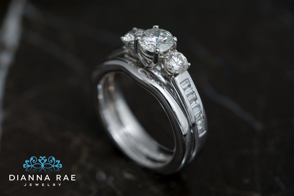 001-03343-001_Custom Three Stone and Baguette Wedding Set_Up.jpg