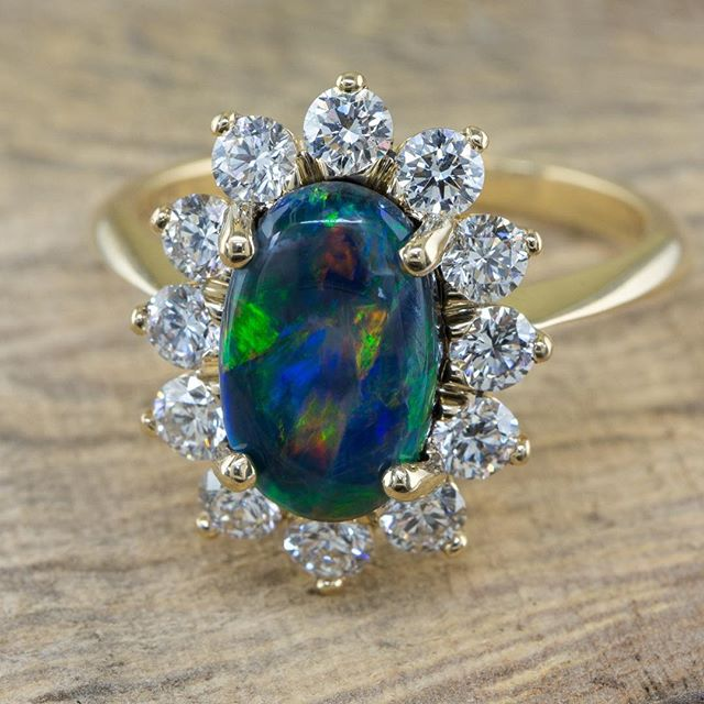 New Black opal cluster ring in stock! Which is prettier.. the diamonds or the opal??