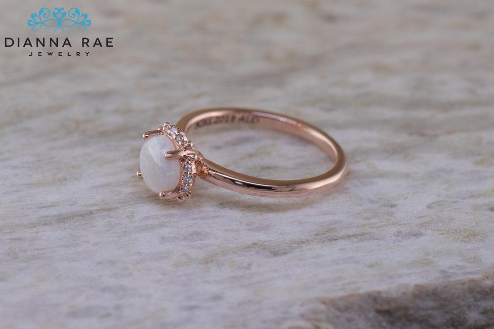 001-04302-001_Custom Rose Gold Round Opal Class Ring.jpg