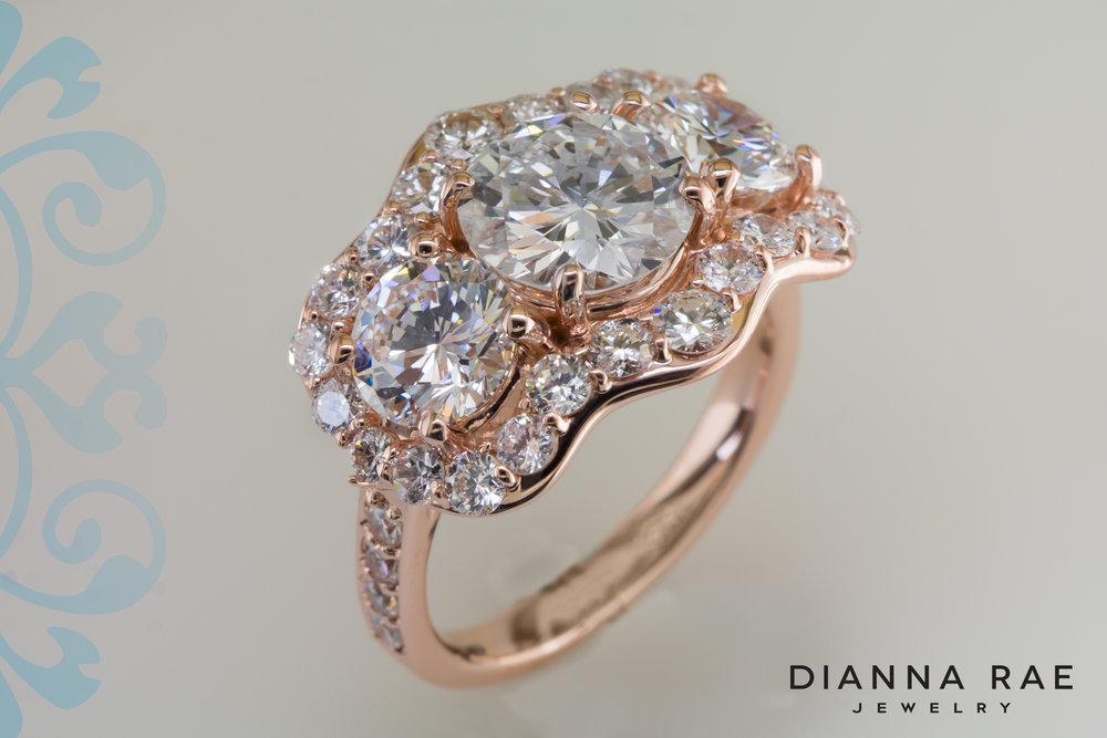 001-03521-001_Custom Three Stone Rose Gold Engagement Ring with Diamond Halo_2.jpg