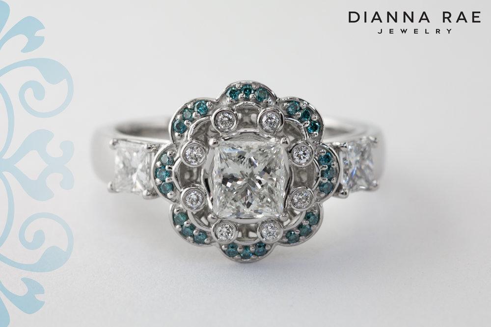 001-03497-001_Custom Blue Diamond Scalloped Halo Three Stone Princess Engagment Ring_1.jpg