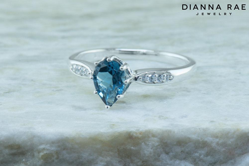001-04397-001_Custom Blue Topaz Sterling Silver Class Ring.jpg