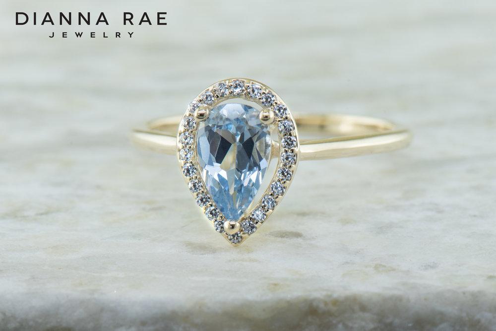 001-04444-001_Custom Aqua and Cubic Zirconia Halo Class Ring.jpg