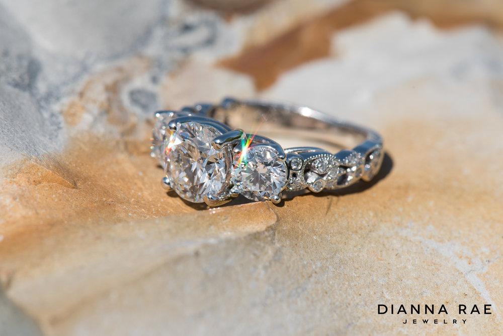 001-03995-001_Custom Three Stone Engagment Ring with Engraved Filigree Shank 01.jpg