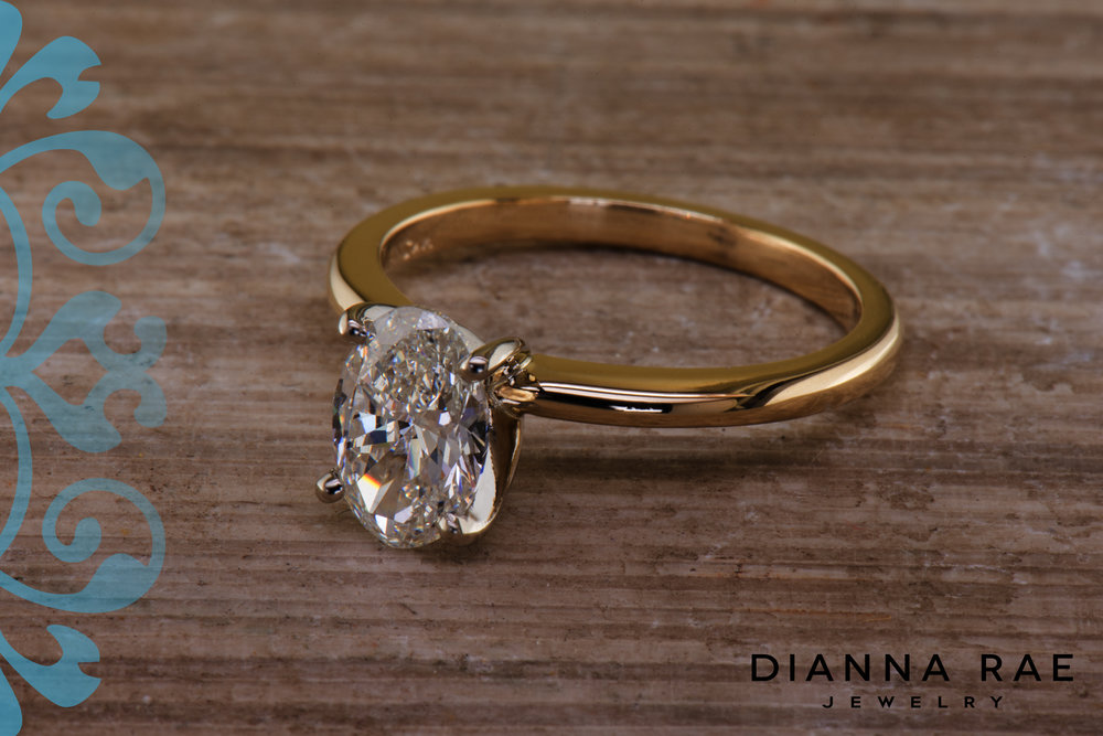 001-04782-001_Two-Tone Yellow and White Oval Solitaire Engagement Ring.jpg