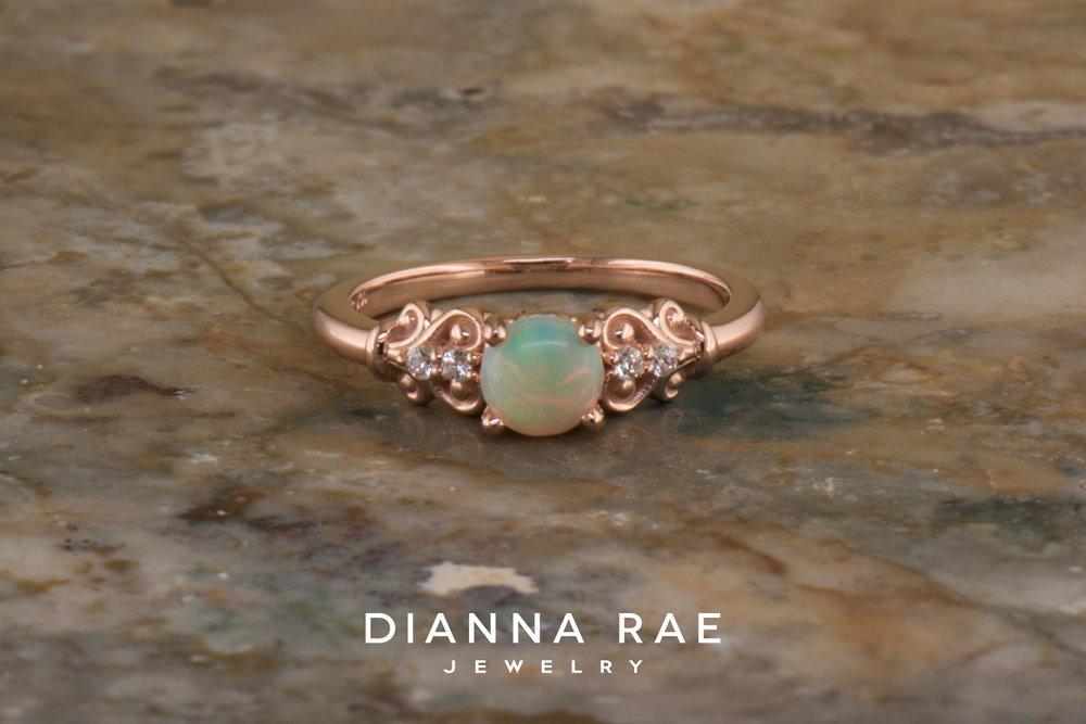 001-04881-001_Custom Rose Gold Scroll and Opal Class Ring.jpg