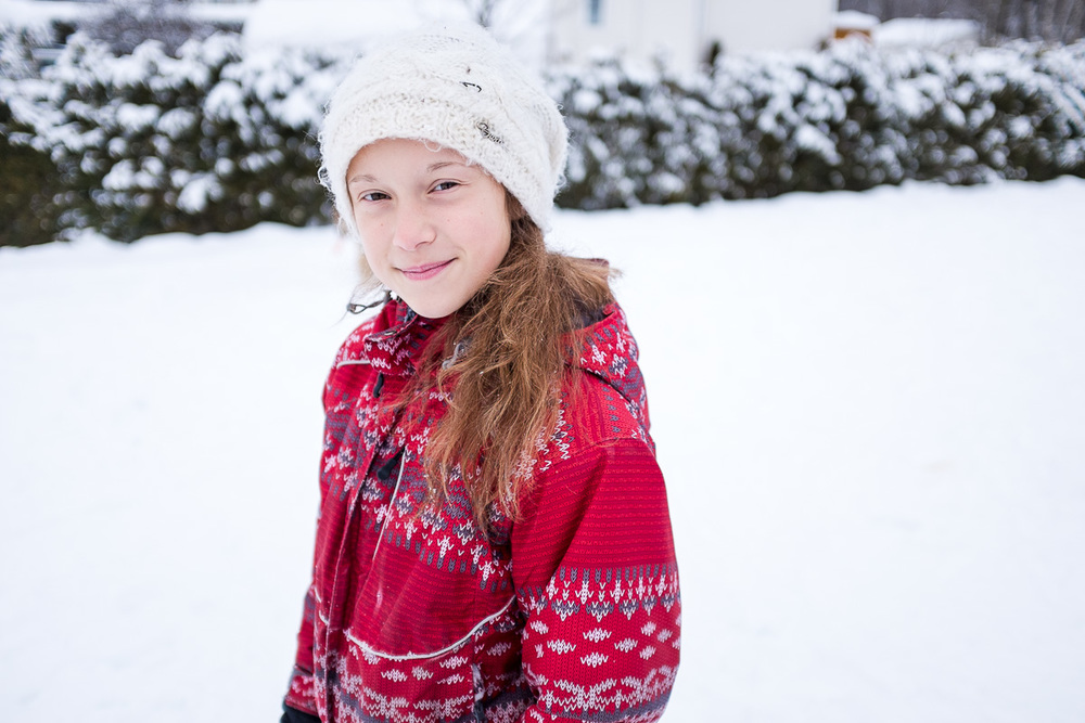My daughter in the little snow we had before the rain took it aw