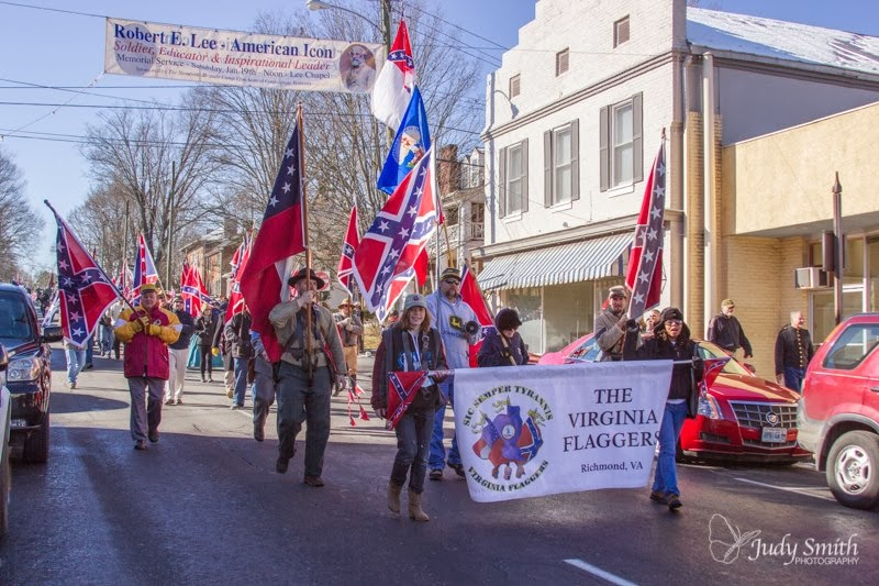 A Confederate flag march on Lee-Jackson day in my hometown of Lexington, VA. Photo source: http://vaflaggers.blogspot.com/2013/12/lee-jackson-day-in-lexington.html