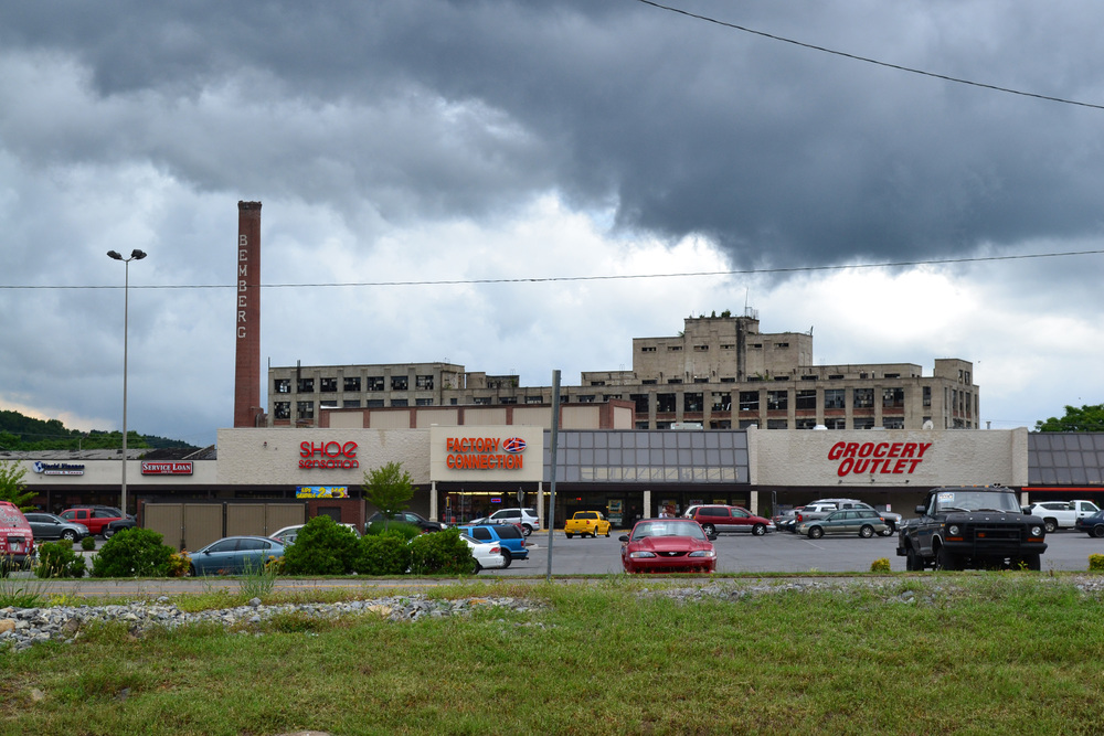 A strip mall sits in front of an abandoned rayon factory in Elizabethton, Tenn. Photo by author.