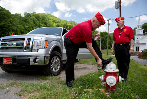 """Rod Mayberry shines his shoes as he and Dan Brewer, both members of the Bluefield Marine Corps League, prepare to participate in a Memorial Day parade in Bramwell, Mercer County, West Virginia.""    (  Photo courtesy Looking at Appalachia, Photographer Lauren Pond  )"