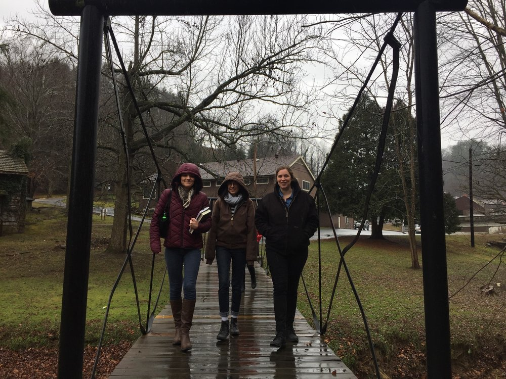 Caption 2: App Fellows crossing the Troublesome Creek at Hindman Settlement School on a tour of campus. Photo by Abby Huggins.