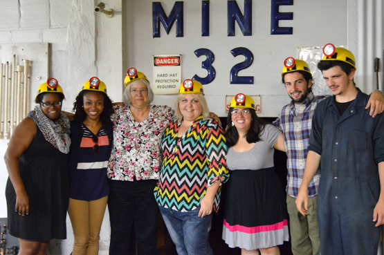 Highlander Center staff and Appalachian Transition Fellows don helmets in preparation for a trip into a mine at the Coal Mine Museum in Benham, Ky.  Photo by Catherine Moore