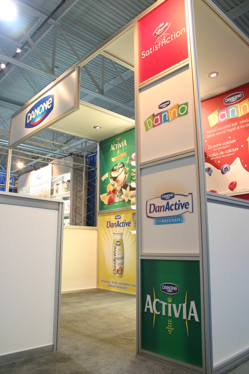 Trade show photo of Danone's 10' x 10' display rental with printed graphics