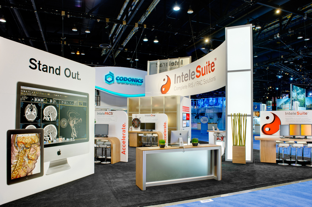 A view of Intelerad's trade show booth rental showing the large graphics and light tower