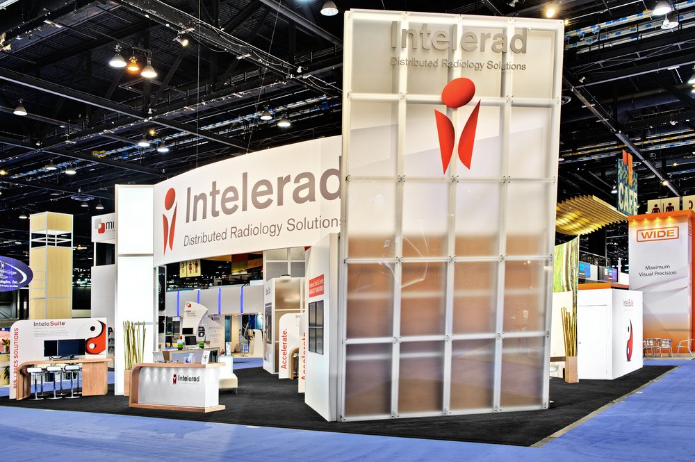 Intelerad's trade show booth rental with a photo of the custom acrylic slanted wall