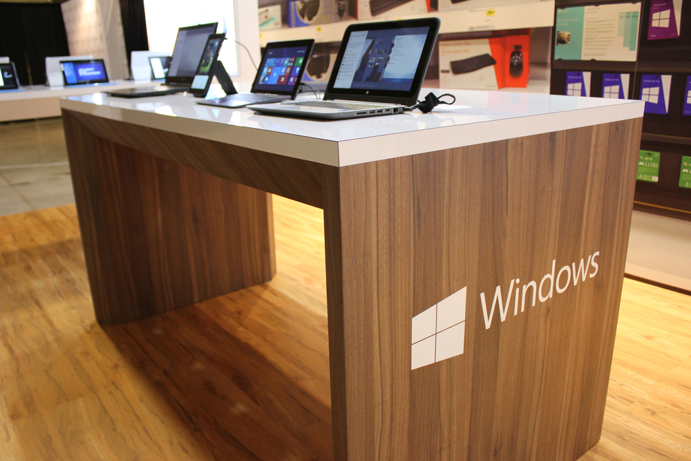 For this Windows 8 booth we incorporated wood flooring, custom millwork to craft the device bars, backlit graphics and an interactive back wall