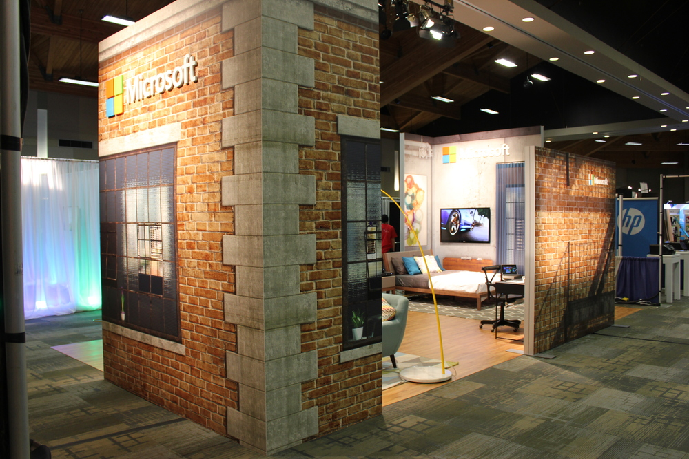 Large digitally printed graphics, wood flooring, and designer staging allows Microsoft to showcase product in an experiential way