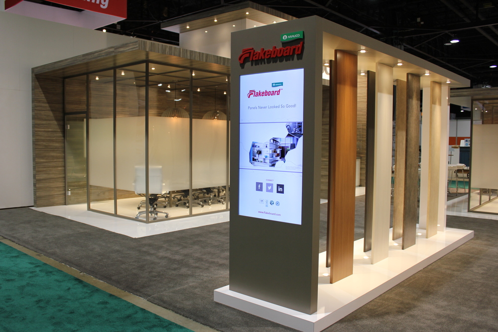 The Arauco booth is a fully custom exhibit with cutom cabinetry and millwork incorporating the client's own wood products on the strucutre and in lighting