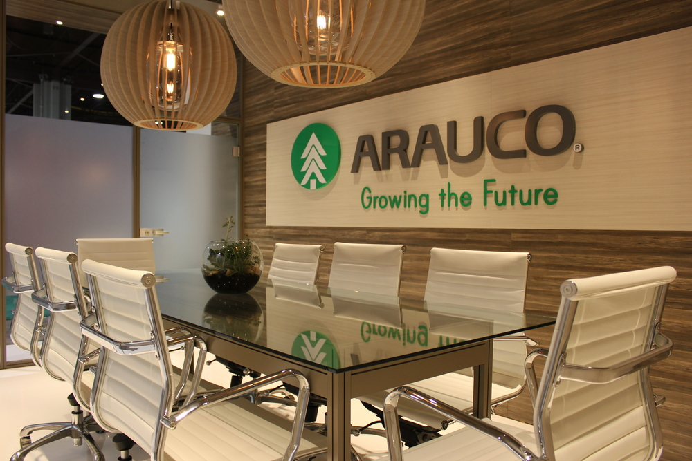 The Arauco booth is a fully custom exhibit with cutom cabinetry and millwork incorporating the client's own wood products on the strucutre and in the lights