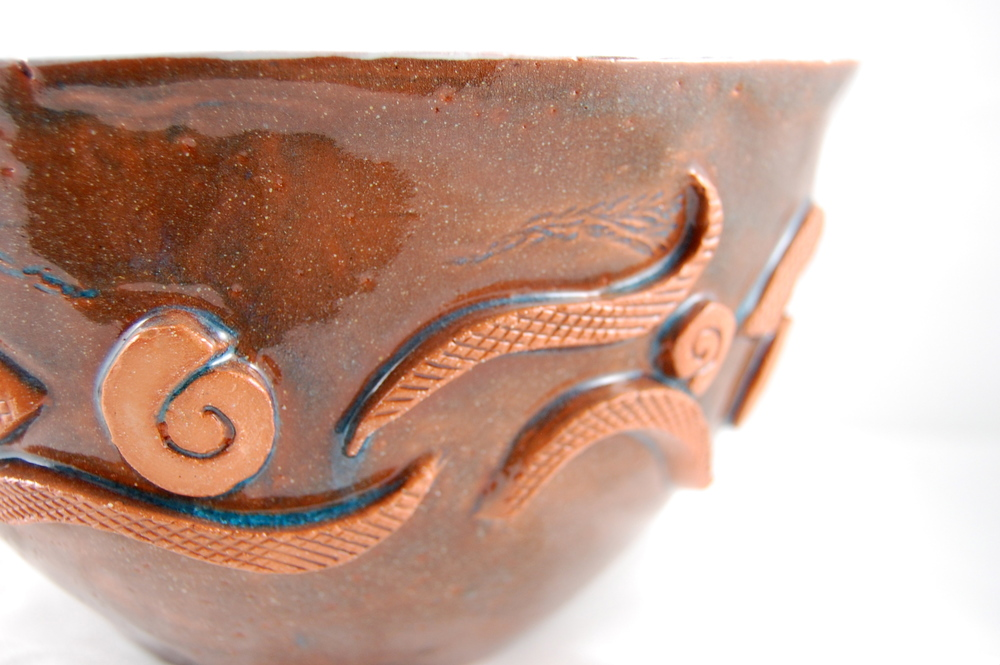 """Detail of """"Tribal Song"""", hand built and sculpted earthenware bowl. Lisa Codella, 2010."""