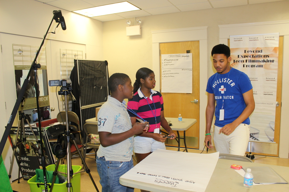 Beyond Expectations students brainstorm ideas for their television segments.