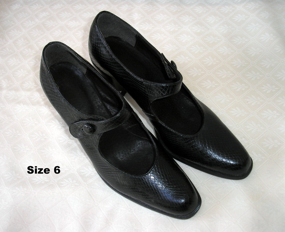Black chunky-heeled Mary-Jane style with button fastening. Narrow fitting. Worn once. £15