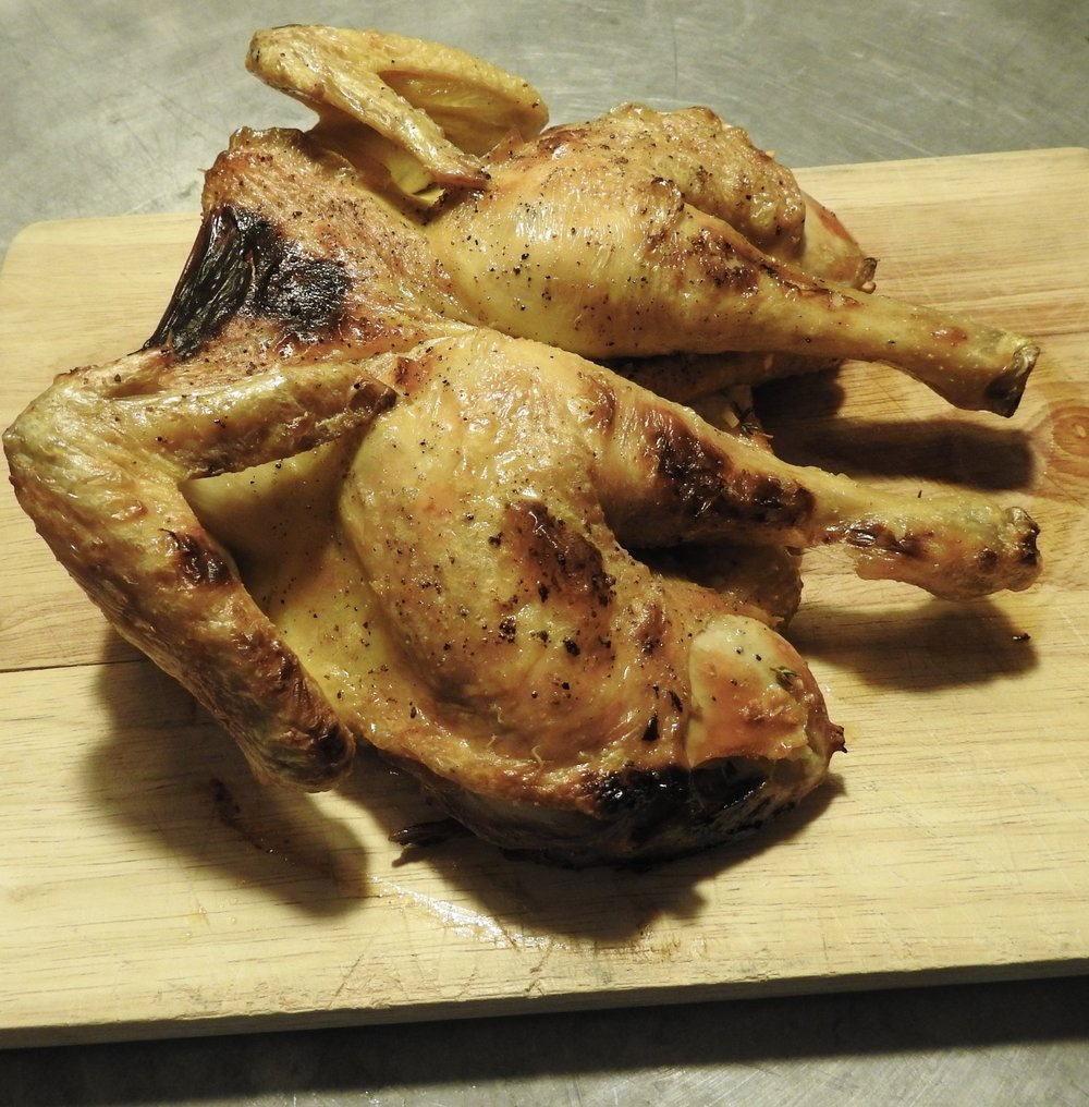 Split roasted chicken with preserved lemon