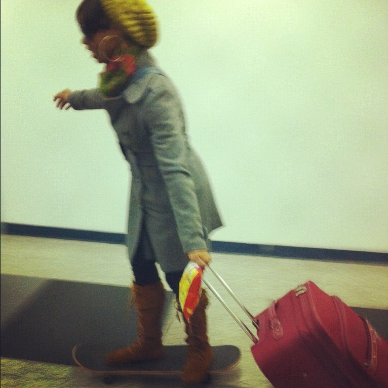 Desk of the Day: Skateboard in the airport. It's safe…with Cheese Doodles in hand.