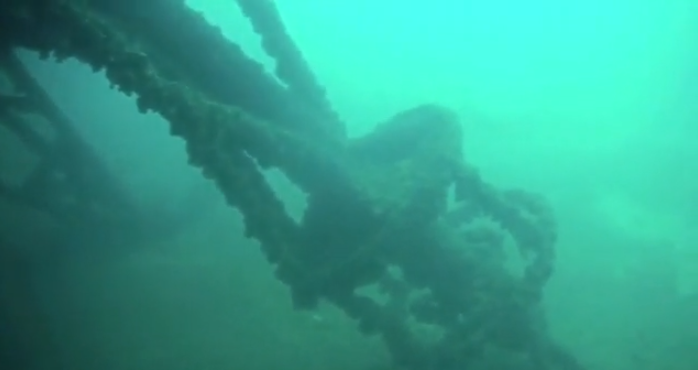 The Cedarville leans on her side. Watch Episode 16 of Season 1 to see more underwater video of this huge shipwreck.