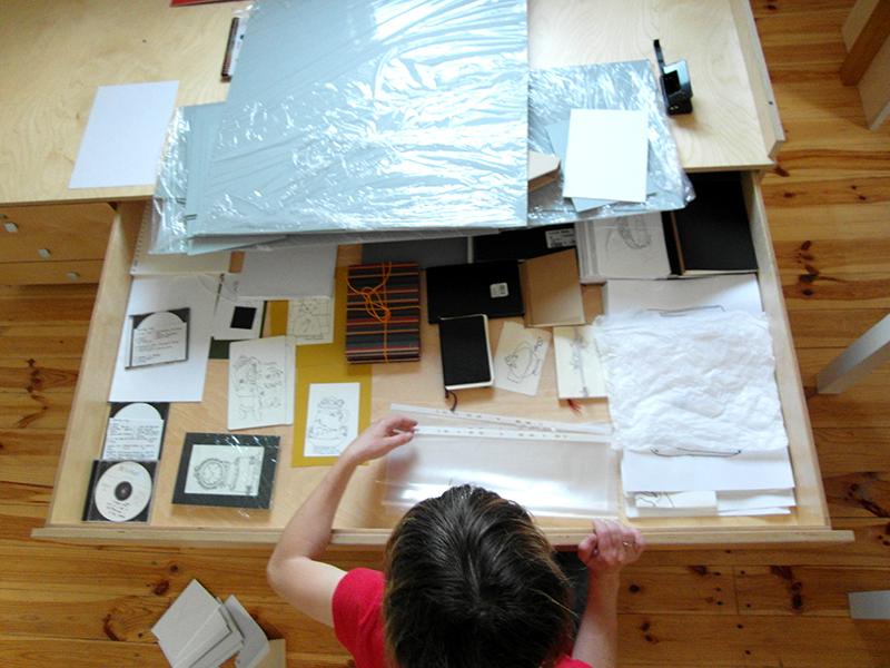 Alevtina looking through work in her studio