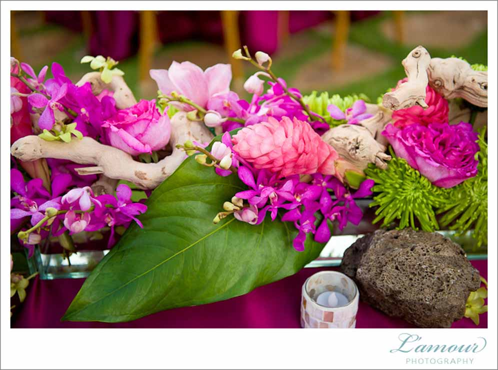 tropical berry color and lava rock centerpiece by Passion Roots | Oahu, Hawaii