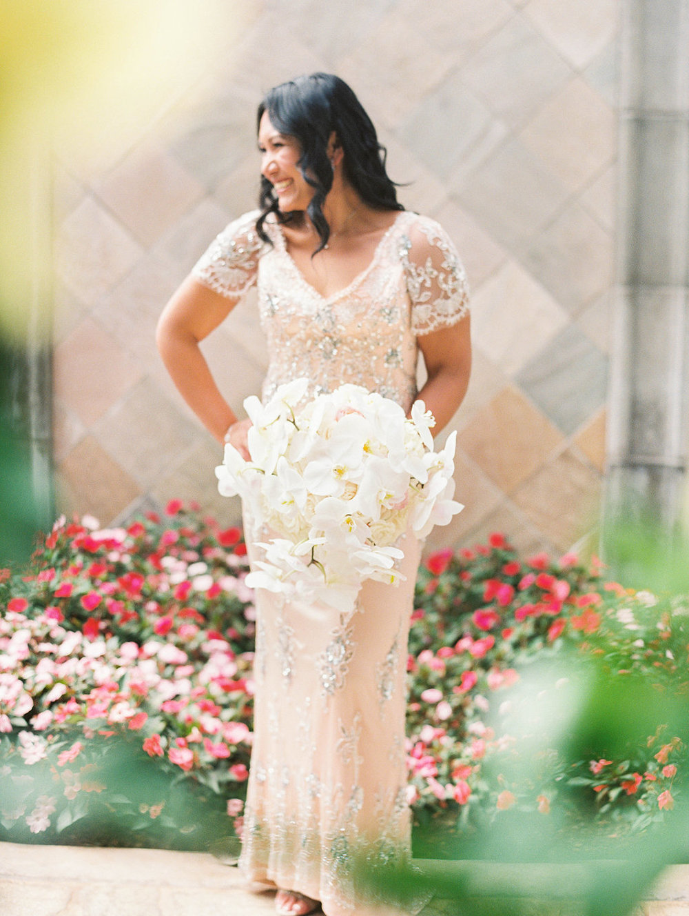 cascading white orchid bouquet by Passion Roots | Ashely Goodwin Photography | Oahu, Hawaii