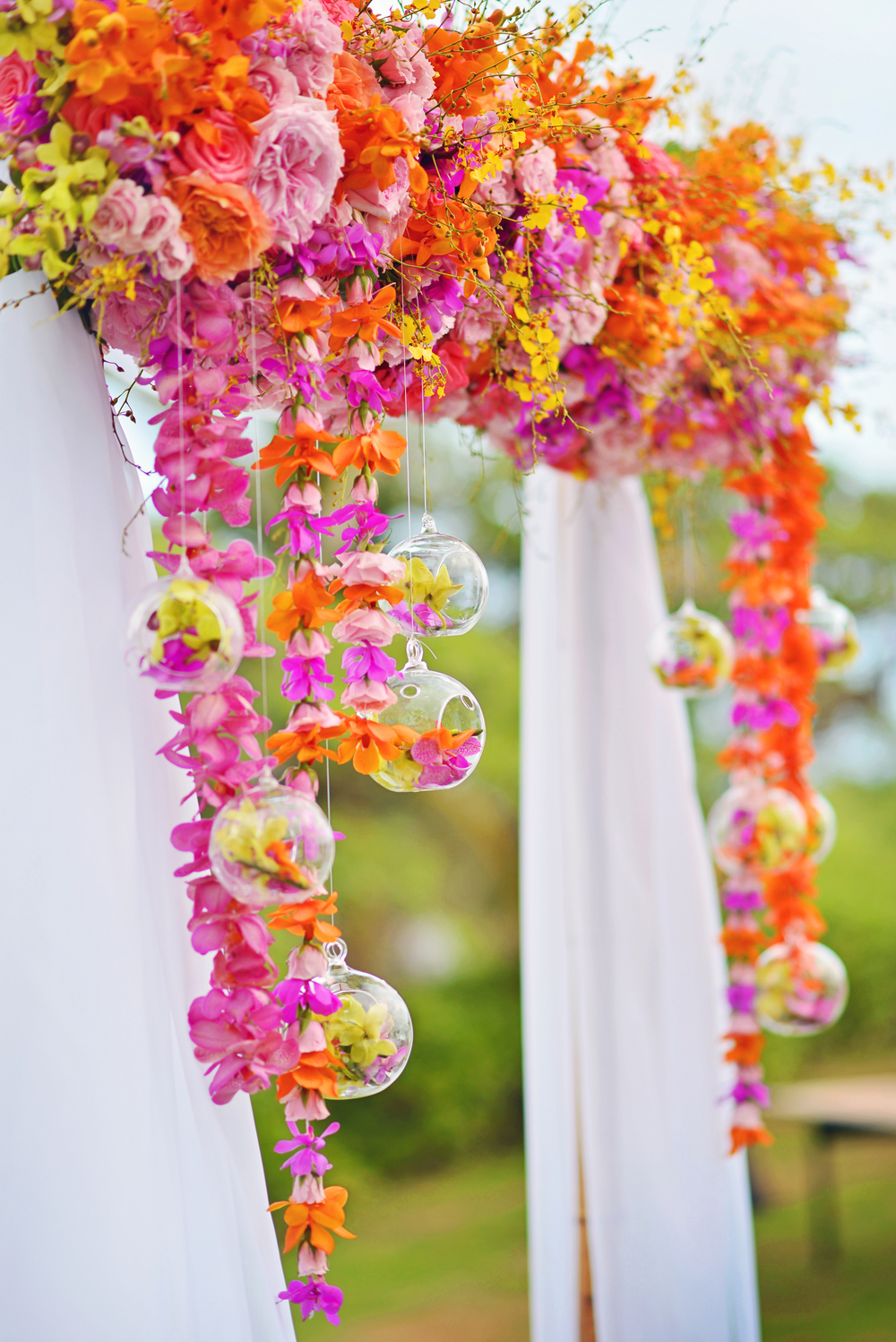 bright orange and pink tropical ceremony arch flowers by Passion Roots | Stephen Ludwig Photography | Oahu, Hawaii