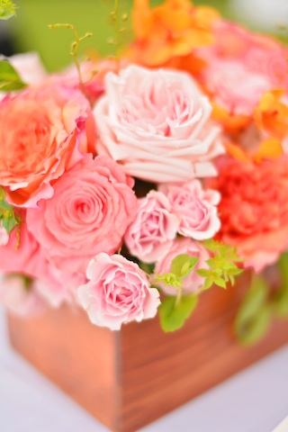 orange and pink centerpiece in wood box by Passion Roots