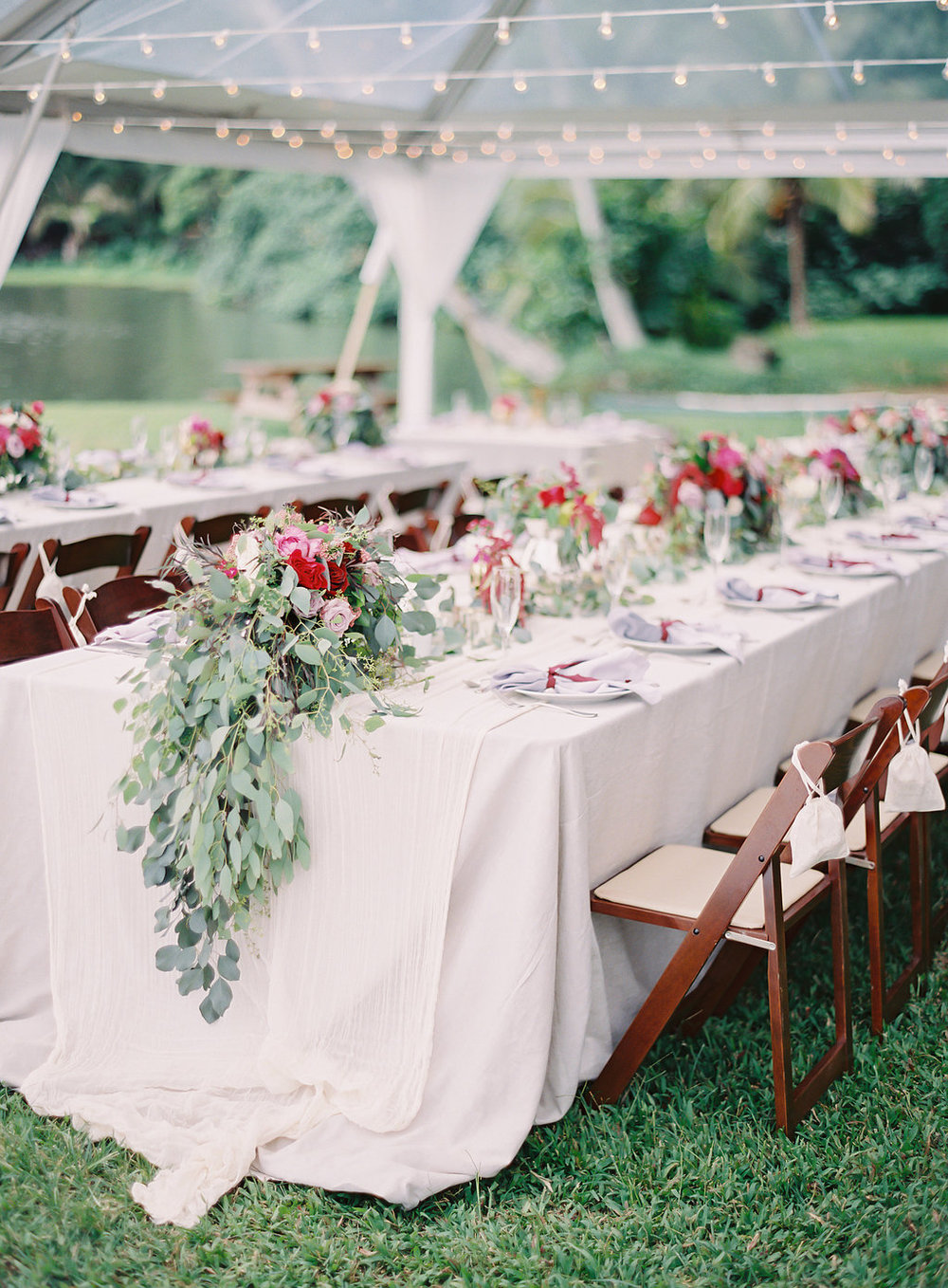 berry colored arrangement with seeded eucalyptus draping by Passion Roots / The Great Romance Photography