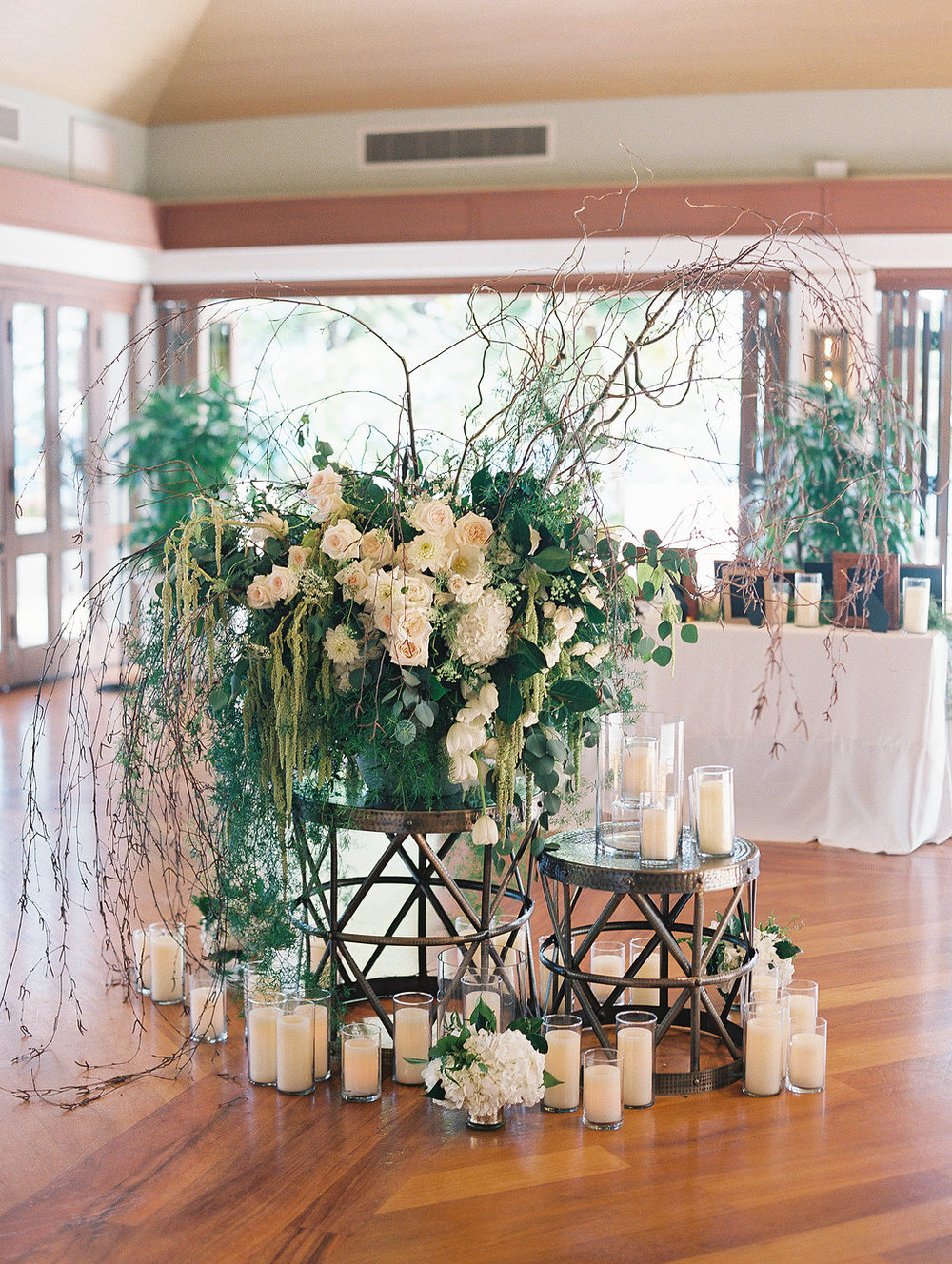dramatic white and green flower arrangement with candles by Passion Roots / Ashley Goodwin Photography