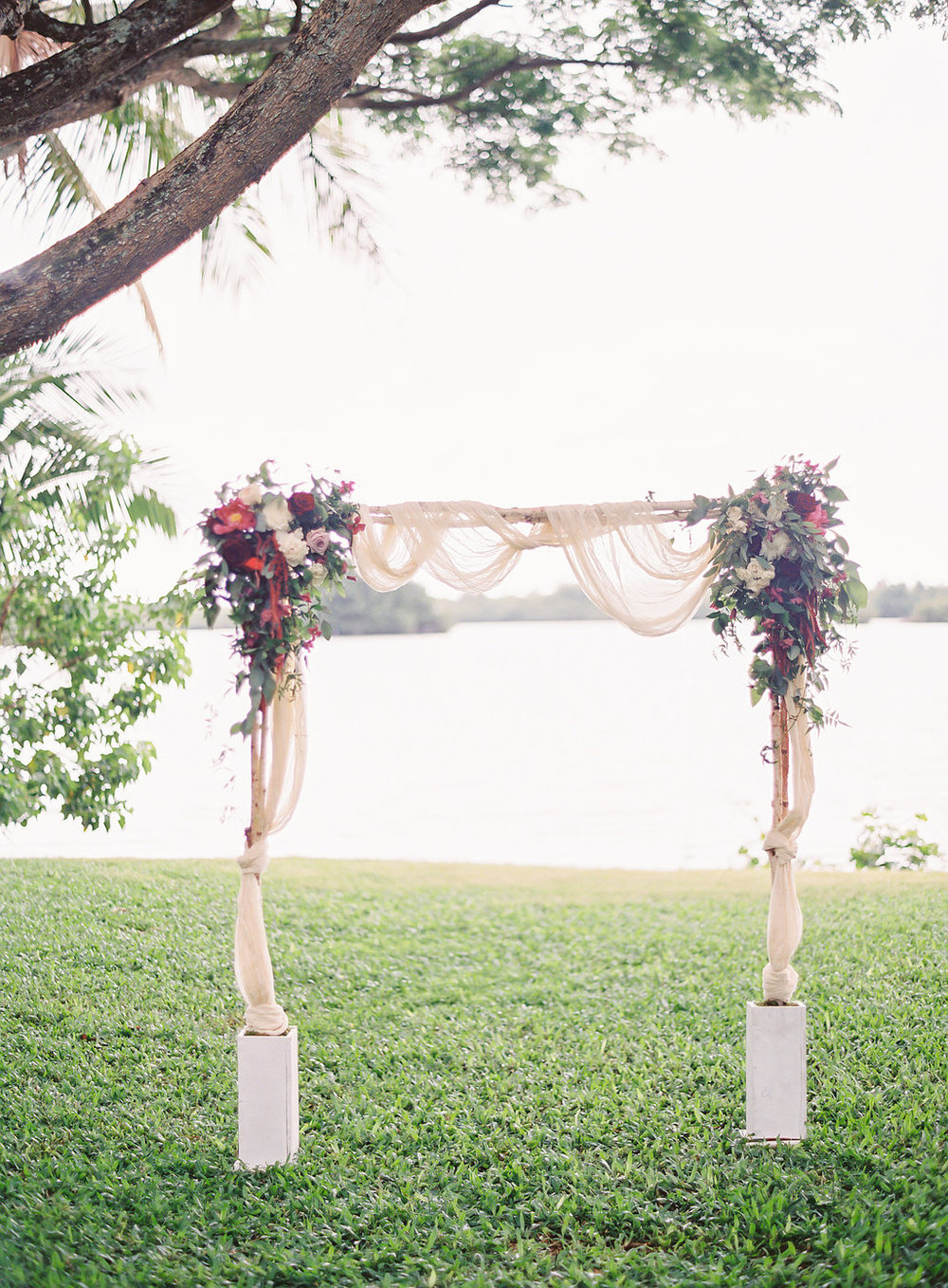 romantic berry and wine flowers with fabric draping on ceremony arch by Passion Roots / The Great Romance Photography