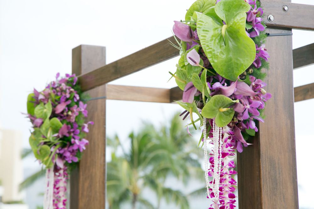 tropical green anthurum and purple orchid ceremony arbor by Passion Roots | Garrett Nose Photography | Oahu, Hawaii